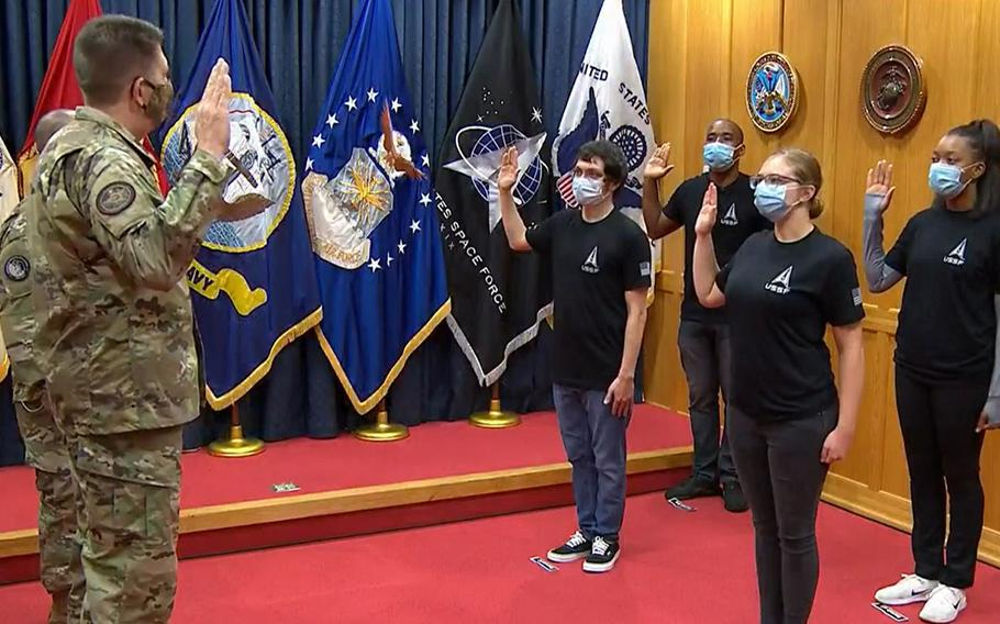 In this image from video streamed on social media, Gen. David Thompson, the vice chief of space operations, swears in Space Force's first recruits Tuesday, Oct. 20, 2020, at Baltimore Military Entrance Processing Station at Fort Meade, Md.