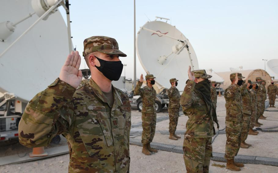U.S. Air Force company grade officers raise their hands during an oath of office ceremony at Al Udeid Air Base in Qatar as they transferred into the Space Force on Sept. 1, 2020.