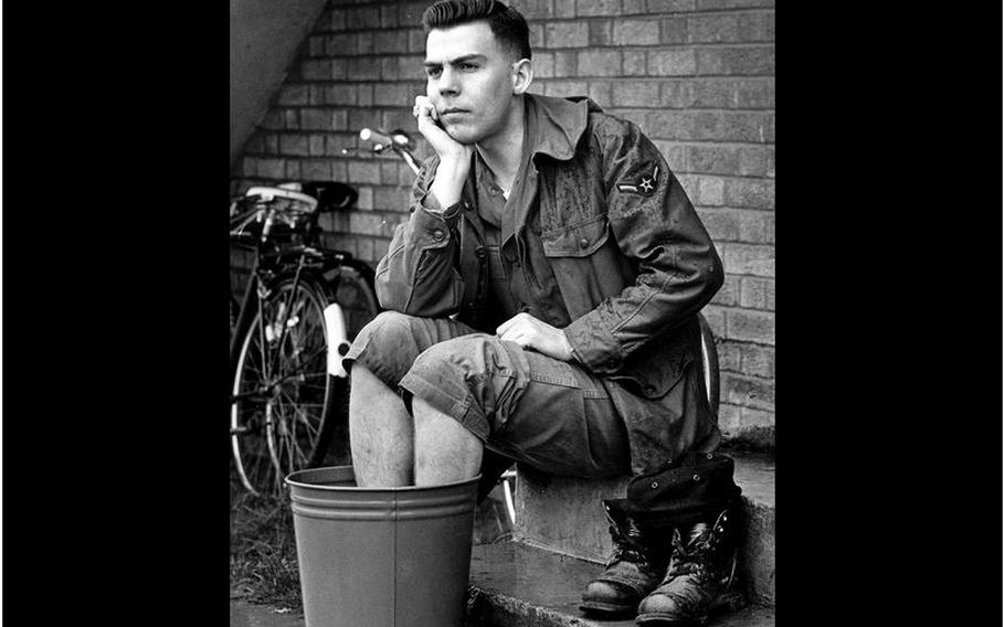 RAF Croughton, England, April, 1966: Airman 3rd Class William W. Spurlock soaks his feet after one of his long hikes.
