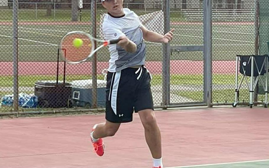 Senior Liam Hunter drives a forehand smash during Friday's Japan tennis matches at Misawa Air Base. Hunter won both his singles matches and teamed with Gabe Rayos to win their doubles matches.