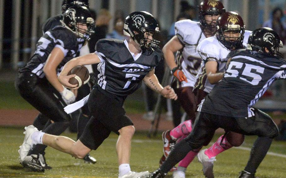Zama quarterback Dominic Peruccio dashes to the end zone for a 4-yard touchdown run.