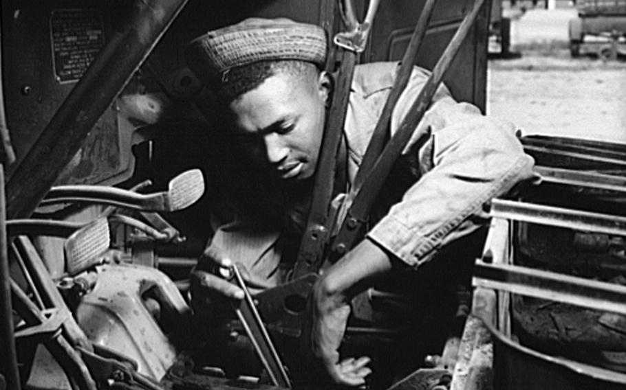 An African American soldier, who serves as a truck driver and mechanic, works on a transmission at Fort Knox, Ky., in 1942. In 1943, a bloody battle between Black and white U.S. soldiers took place at Bamber Bridge, England. Several of the Black soldiers were in transportation units. At the time, military units were segregated, with Black units mostly having white commanders.