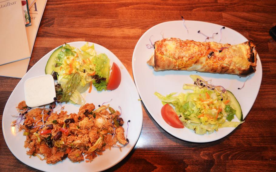 Havana Restaurant's arroz con pollo, left, and a rolla a la abuela, a fried burrito. The Wiesbaden, Germany, restaurant serves food inspired by multiple Latin American countries.