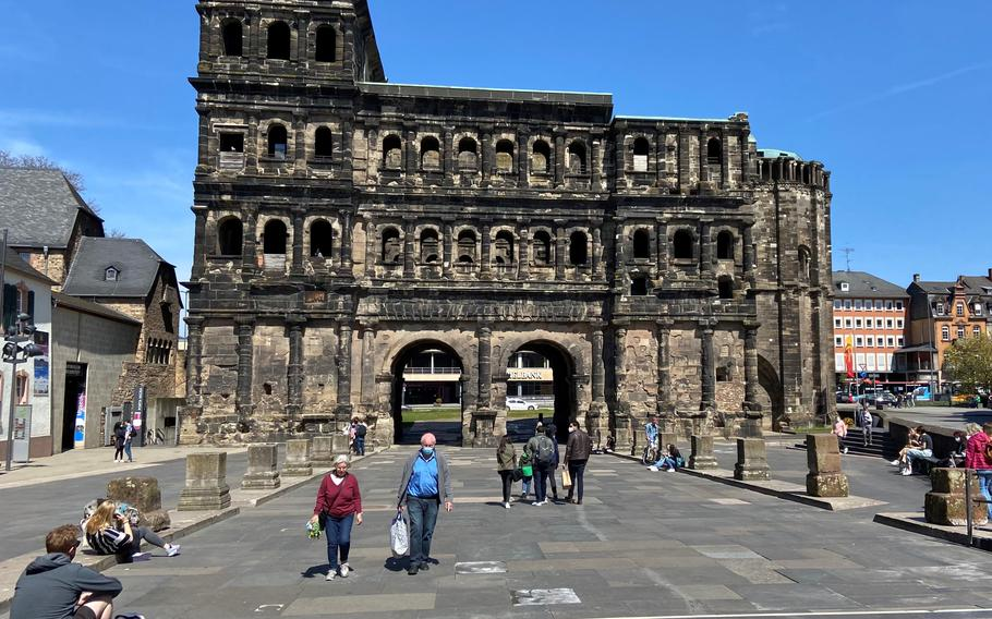 Porta Negra, an ancient Roman city gate in Trier, Germany where tourists often gathered in large groups prior to the pandemic, on April 24, 2021. The pace of vaccinations in the U.S. has prompted the European Union to begin the process of loosening travel rules for Americans who have proof they've been fully immunized, paving the way for tourist travel this summer.   Ann Pinson/Stars and Stripes