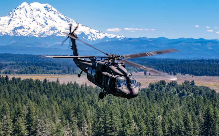 """A UH-60 helicopter assigned to Bravo """"Bigfoot"""" Company, 2-158 Assault Helicopter Battalion, 16th Combat Aviation Brigade, conducts a reenlistment flight to Whidbey Island, Wash., on Jun. 17, 2021."""