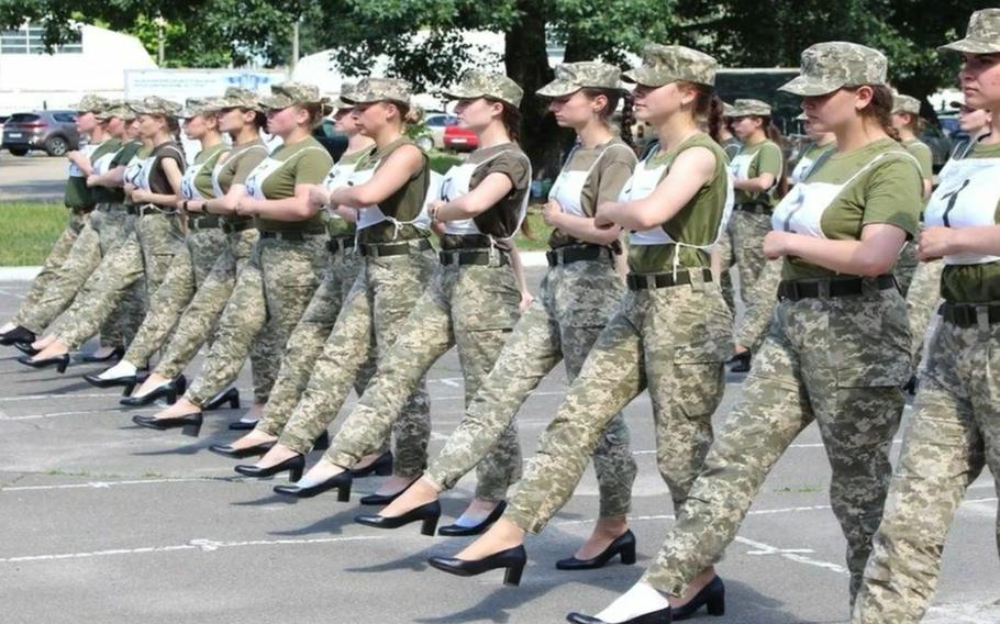 Ukraine's defense ministry released photos showing female cadets drilling for an Aug. 24 independence day procession in camouflage pants and black pumps with chunky heels.