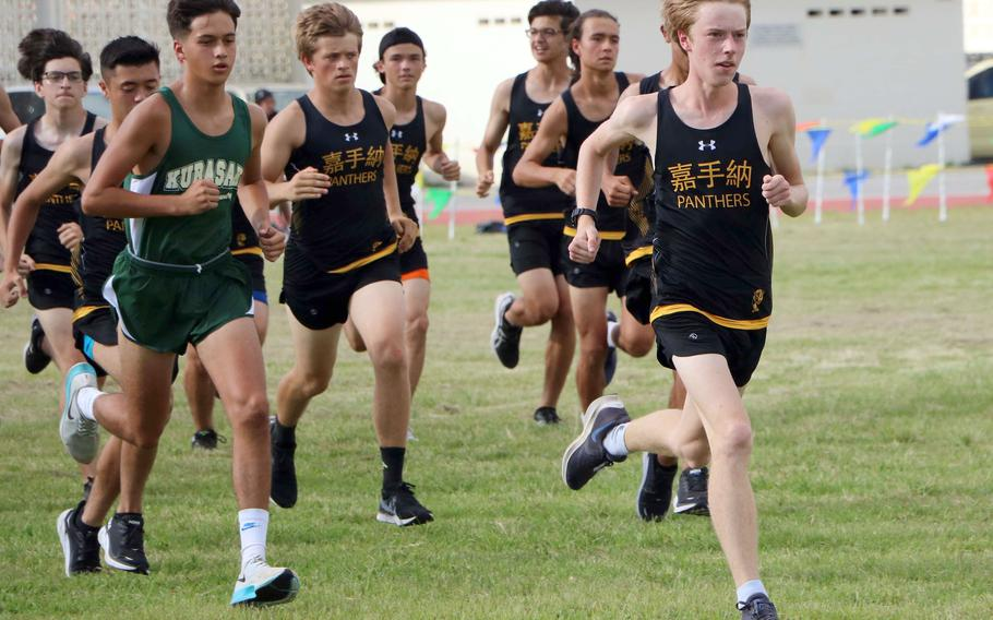 Kadena's Cullen Oglesbee leads the pack outbound during Friday's Okinawa season-opening cross country race. Oglesbee won with a time of 17 minutes, 36 seconds.