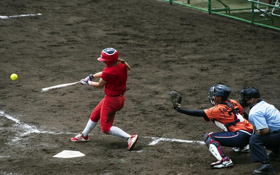 Haylie McCleney, an outfielder for the U.S. Women's Olympic softball team, hits a line drive during an exhibition game against the Hitachi Sundivas in Iwakuni, Japan, Monday, July 12, 2021.