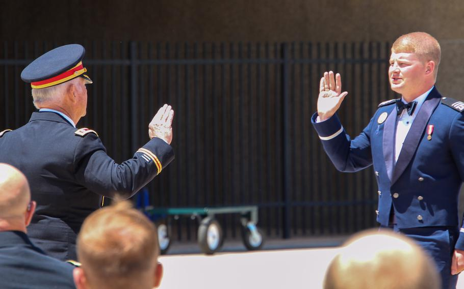 Tanner Johnson is sworn in as a U.S. Space Force officer by his grandfather, retired Army Lt. Col. Terry Johnson, at a ceremony at the U.S. Air Force Academy in Colorado Springs, Colo., May 25, 2021. A year earlier, Tanner Johnson was diagnosed with Type 1 diabetes and was told his military career was over.