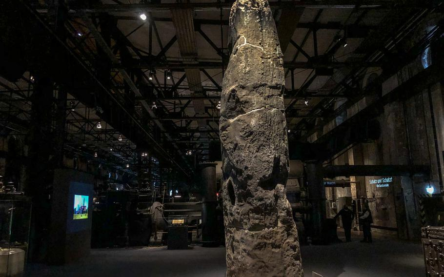 Standing about 20 feet tall, the Gollenstein, the region's largest menhir, or upright standing stone, is displayed at Voelklingen Ironworks in Voelklingen, Germany.