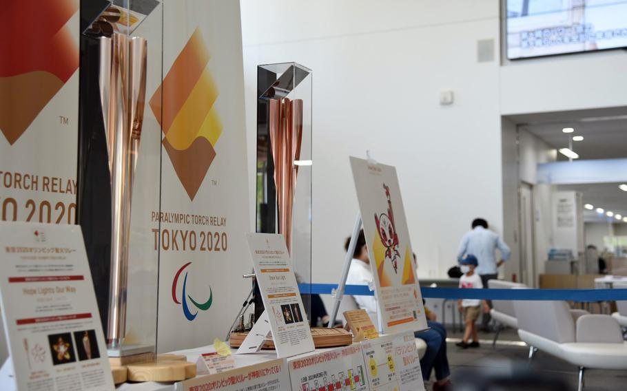 Torches for the Olympic and Paralympic games are on display at Chigasaki City Hall in Kanagawa prefecture, Japan, Tuesday, June 8, 2021.