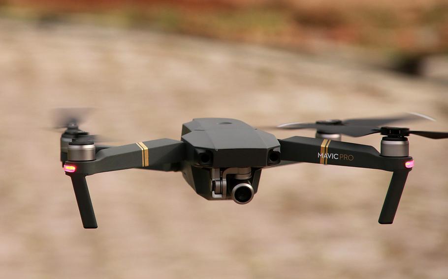 A DJI Mavic Pro drone in flight.