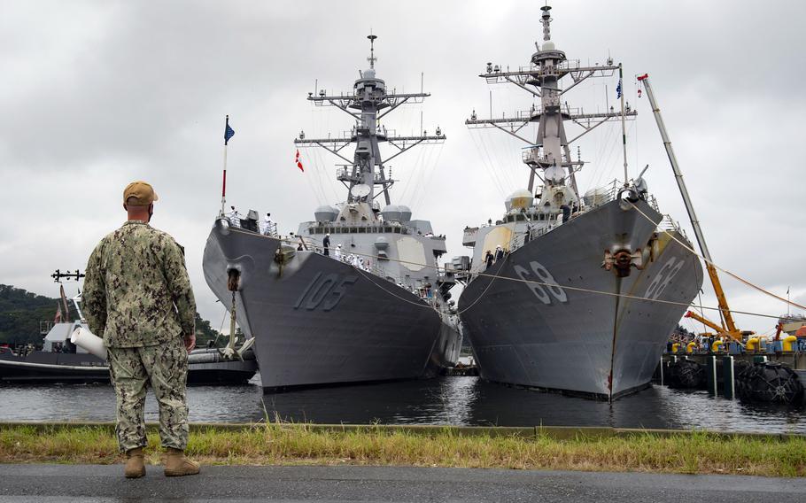 Yokosuka Command Master Chief Robert Beachy watches as the guided-missile destroyer USS Dewey, left, moors alongside USS The Sullivans at Yokosuka Naval Base, Japan Wednesday, Sept. 8, 2021.