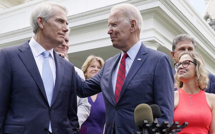 President Joe Biden speaks with Sen. Rob Portman, R-Ohio, on Thursday June 24, 2021, outside the White House in Washington.