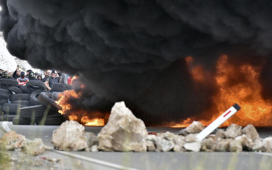 Smoke rises from burning tires which protesters set fire at one of the blockades near Cetinje, Montenegro, Sunday, Sept. 5, 2021.