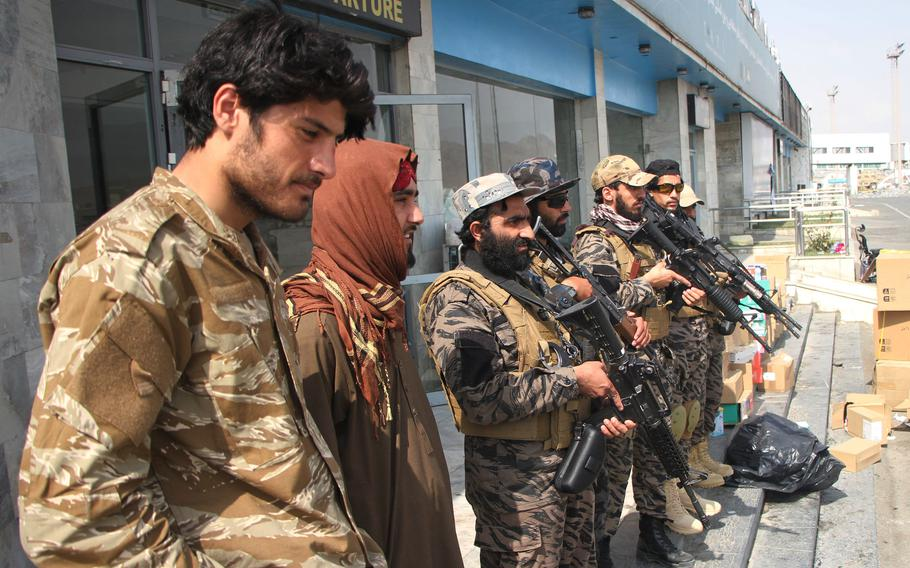 Taliban members are at the airport in Kabul, Afghanistan, Aug. 31, 2021.