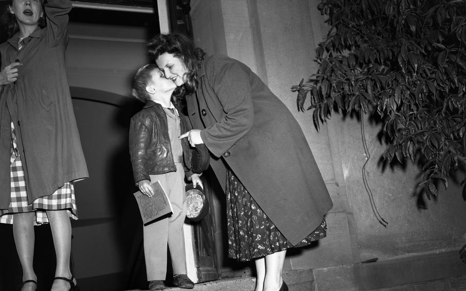 Wayne Nicolosi gives a goodbye kiss to his mom, who walked the children to the Heidelberg dependents' school Sept. 7, 1948.