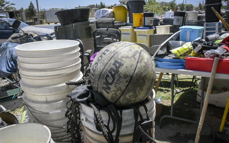 Items such as basketballs thrown out by U.S. and NATO troops departing Bagram Airfield, Afghanistan, are available for sale at shops outside the base June 5, 2021.