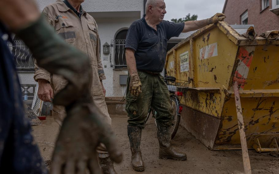 Horst Schmeing cleans the flood-damaged house of his nephew in Bad Neuenahr, Germany on July 16, 2021.