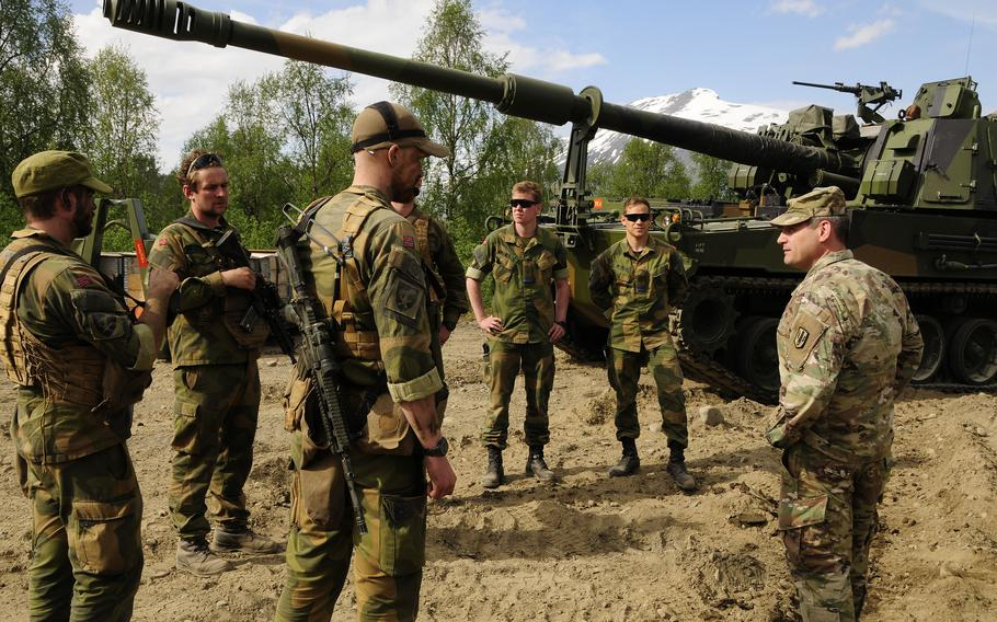 Col. Daniel Miller, 41st Field Artillery Brigade commander, meets with Norwegian artillery soldiers to observe firing with the K-9 self-propelled howitzer during Exercise Thunderbolt on June 9, 2021, in Setermoen, Norway.