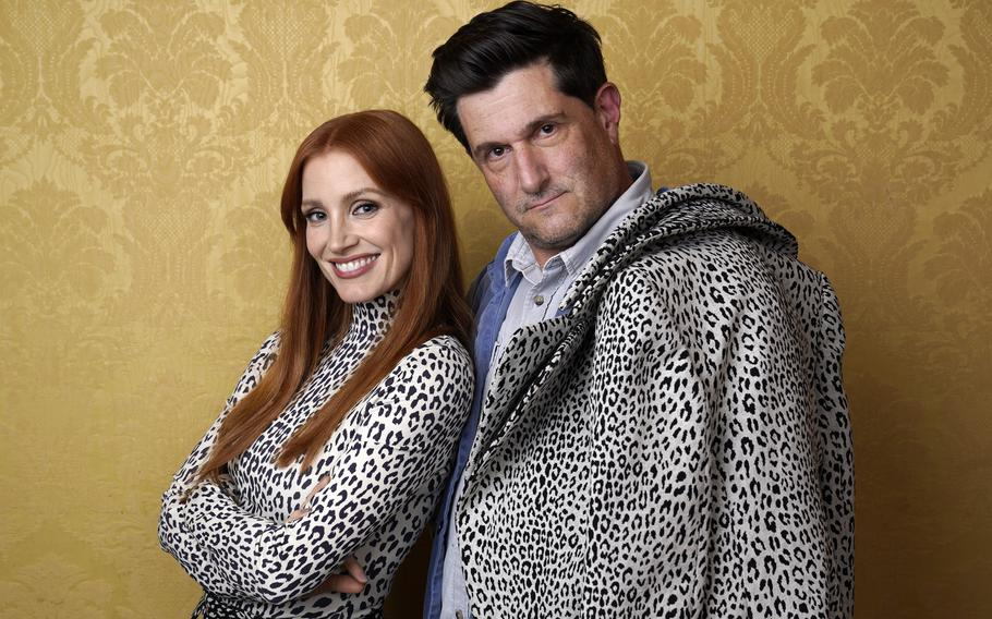 """Jessica Chastain, left, the star of """"The Eyes of Tammy Faye,"""" poses for a portrait with director Michael Showalter during the 2021 Toronto International Film Festival on Sunday at the Royal Fairmont York in Toronto."""