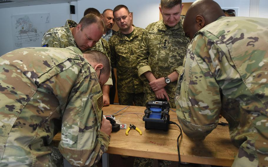 Airmen from the 1st Communications Maintenance Squadron show members of the Ukrainian Air Force a machine that can repair fiber optic cables at Kapaun Air Base in Kaiserslautern, Germany, August 5, 2021.