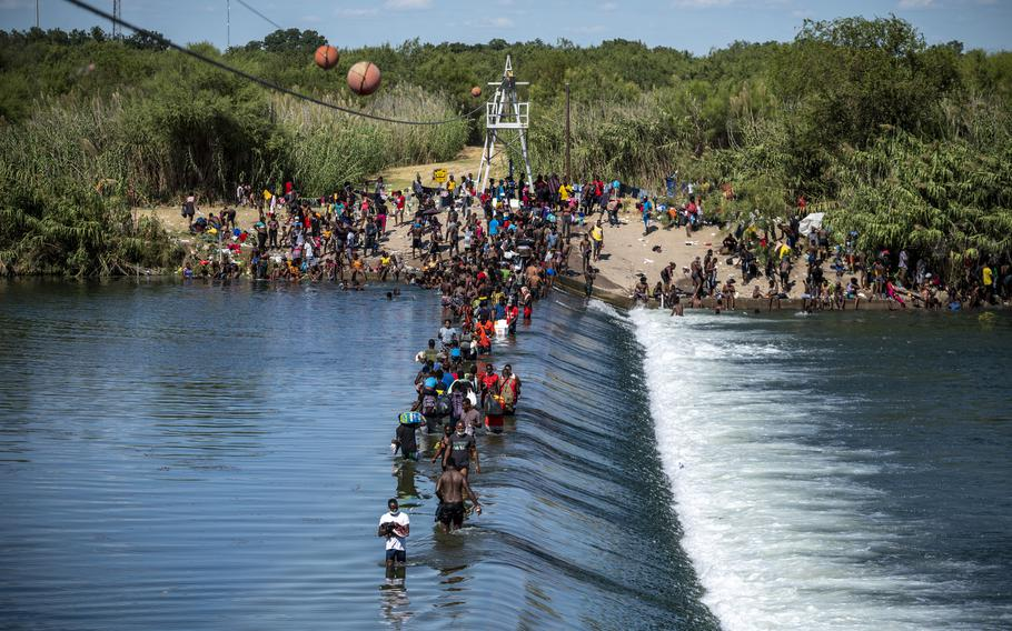 Migrants cross back and forth between the United States and Mexico at the Rio Grande in Ciudad Acuna, Mexico.