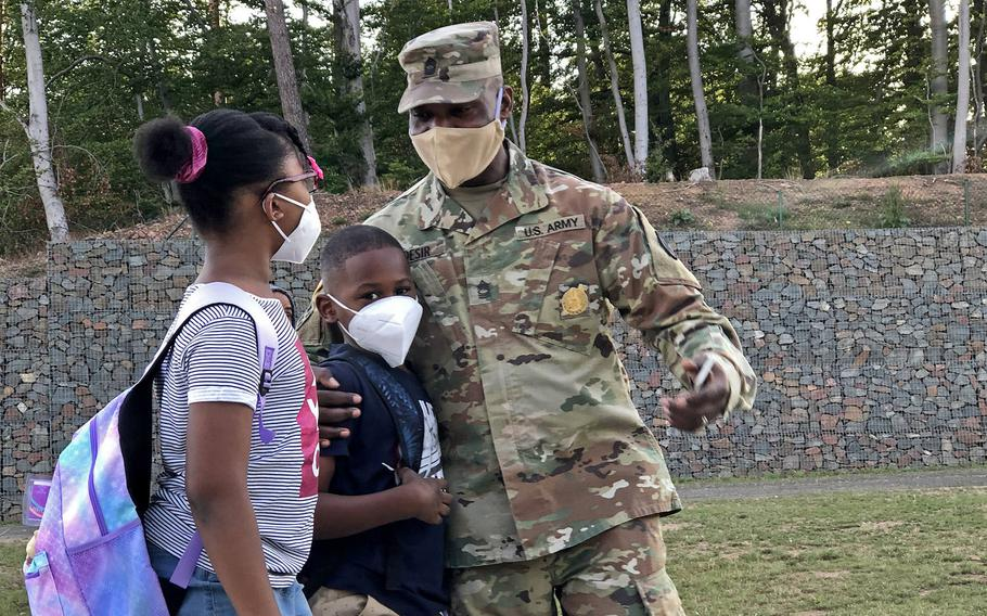 Master Sgt. Faustin Desir, 21st Theater Sustainment Command, says goodbye to his kids before they walk to their classes at Vogelweh Elementary School, Germany, Aug. 24, 2020.