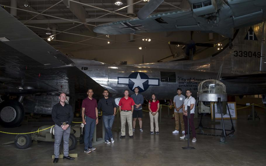 """U.S. Marines with 6th Marine Corps District pose for a group photo next to the """"City of Savannah"""" Boeing B-17 Flying Fortress on display at the Mighty Eighth Air Force Museum in Pooler, Georgia on June 5, 2020."""