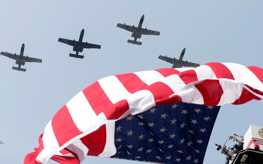 """Planes fly above the funeral procession for Marine Corps Cpl. Humberto """"Bert"""" Sanchez at the corner of 8th Street and East Market Street on Sept. 12, 2021, in Logansport, Ind."""