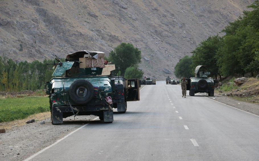 Afghan soldiers pause on a road at the front line of fighting between Taliban and Security forces near the city of Badakhshan, northern Afghanistan, Sunday, July 4, 2021.