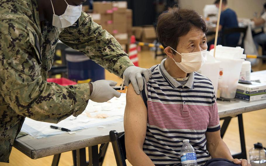 Budget analyst Hiroaki Kayama receives the Moderna COVID-19 vaccine at Yokosuka Naval Base, Japan, Friday, June 18,2021.