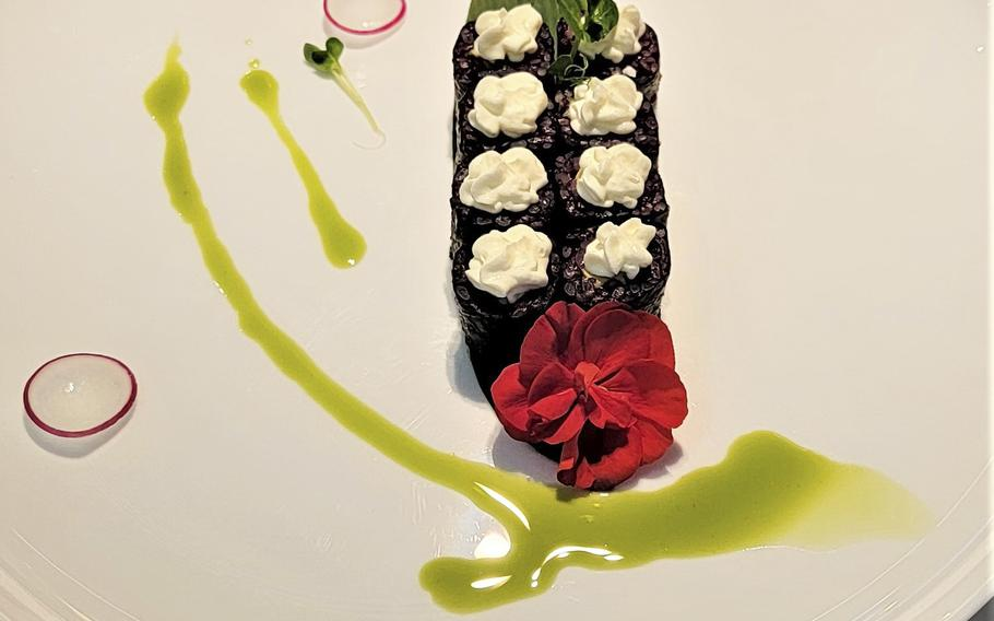 Kashima Sushi serves a delectable assortment of sushi rolls. This is the black rice roll with avocado and cream cheese.