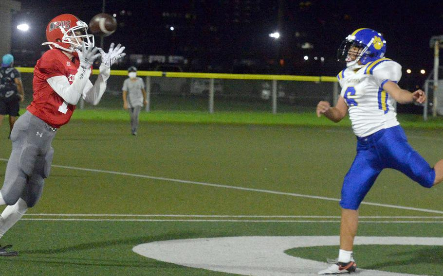 Nile C. Kinnick receiver Ryo Nishiyama hauls in a touchdown pass in front of Yokota defender Tre Perkins.