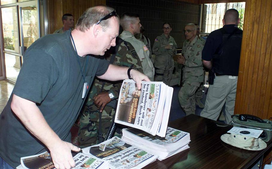 Robert Reismann organizes copies of Stars and Stripes coming fresh off the press in the Middle East in 2007. Reismann, who spent more than 30 years getting newspapers to troops, died Sept. 21, 2021 from complications related to cancer surgery.