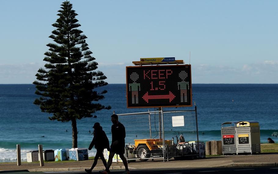 A COVID-19 public health order sign for social distancing on Bondi Beach in Sydney on July 4, 2021.