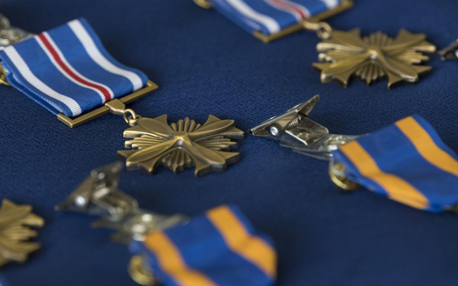 The crew of AC-130 gunship Shadow 71 received Distinguished Flying Crosses and Air Medals for their actions to protect ground forces in Afghanistan in September 2019, at a ceremony at Hurlburt Field, Fla., June 22, 2021.