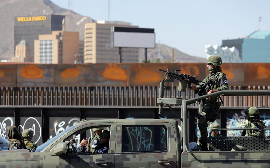 Mexican National Guard soldiers patrol the border between Downtown El Paso and Juarez in 2019.
