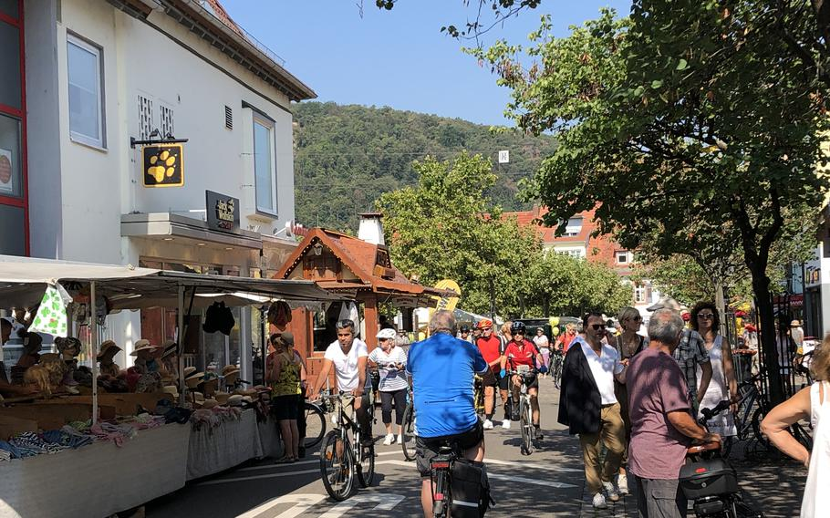 Cyclists and pedestrians crowd the streets of Bad Duerkheim, Germany, on Weinstrasse Experience Day, Aug. 25, 2019. The free bike ride and other events, which usually happen the last weekend of August, have been canceled this year because of the coronavirus pandemic.