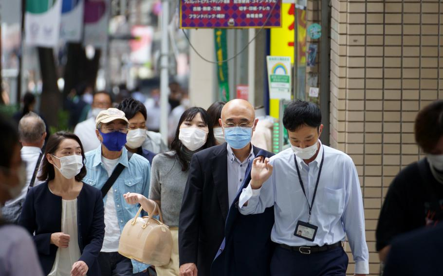 Pedestrians in central Tokyo continued wearing masks while the city remained under a coronavirus emergency on Sept. 8, 2021.