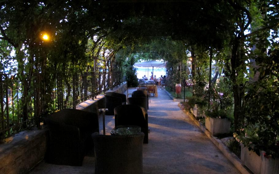 The Catullo Hotel in Sirmione, Italy offers a shaded glade for a drink, before or after a meal.