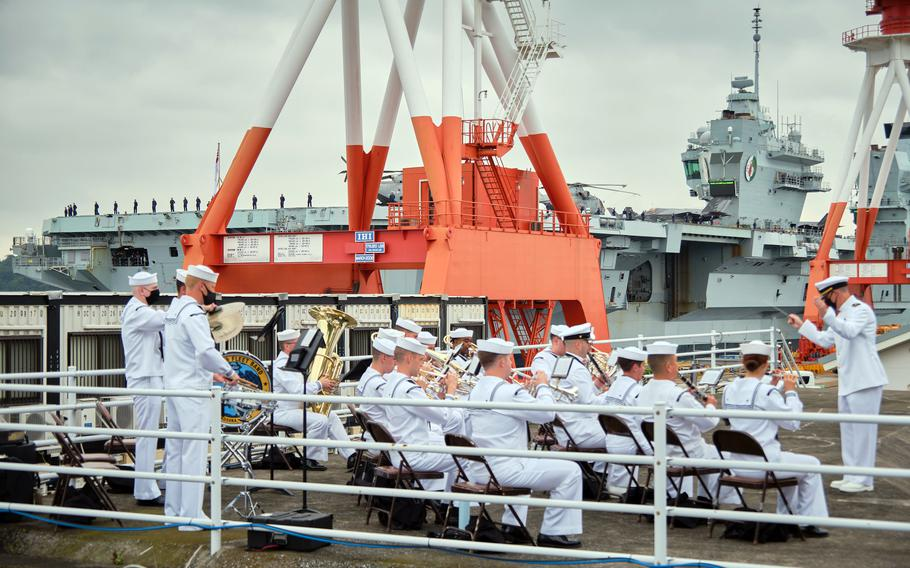 The 7th Fleet Band performs festive music as the Royal Navy aircraft carrier HMS Queen Elizabeth arrives at Yokosuka Naval Base, Japan, Saturday, Sept. 4, 2021.