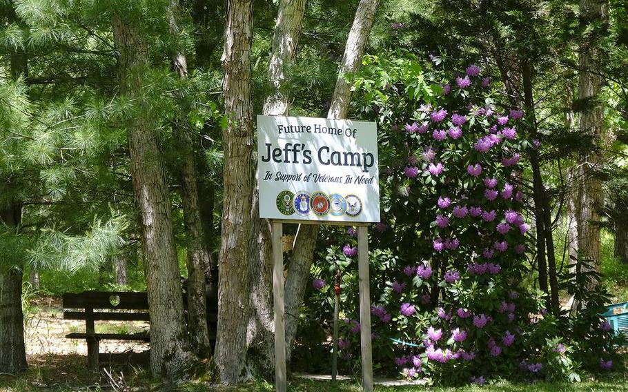 """Property owner Marty Weber has already made up signs for """"Jeff's Camp,"""" a proposed group home, treatment center and wooded retreat on 36 acres"""
