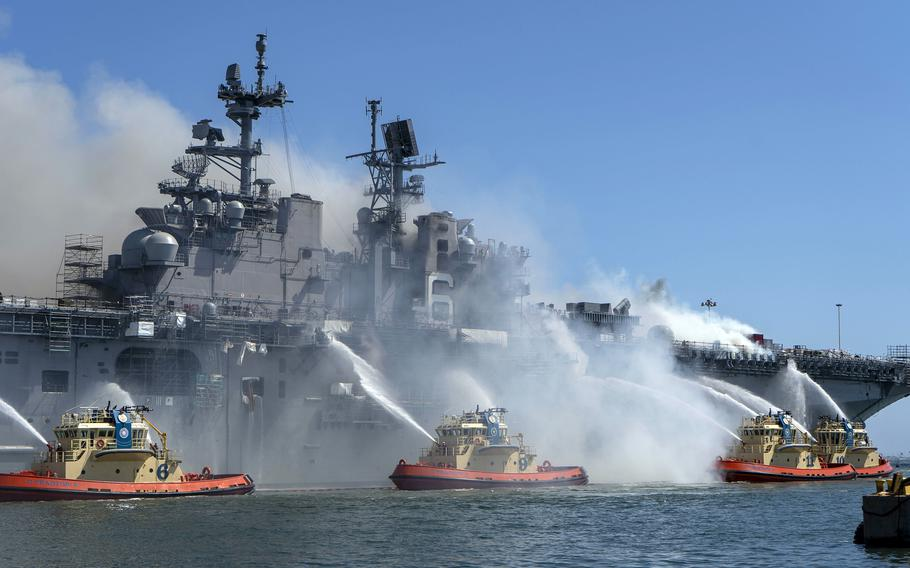 Sailors and firefighters combat a blaze aboard the USS Bonhomme Richard at Naval Base San Diego, July 12, 2020.