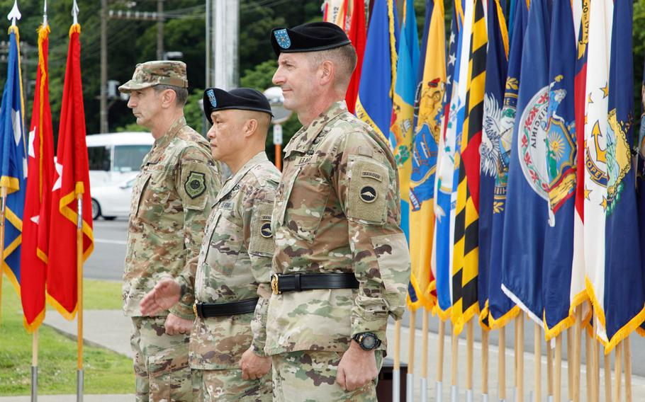 Brig. Gen. Joel Vowell, right, and Maj. Gen. Viet X. Luong, center, prepare for the start of their change-of-command ceremony at U.S. Army Japan headquarters on Camp Zama, Friday, June 25, 2021. U.S. Forces Japan commander Lt. Gen. Kevin Schneider stands at far left.