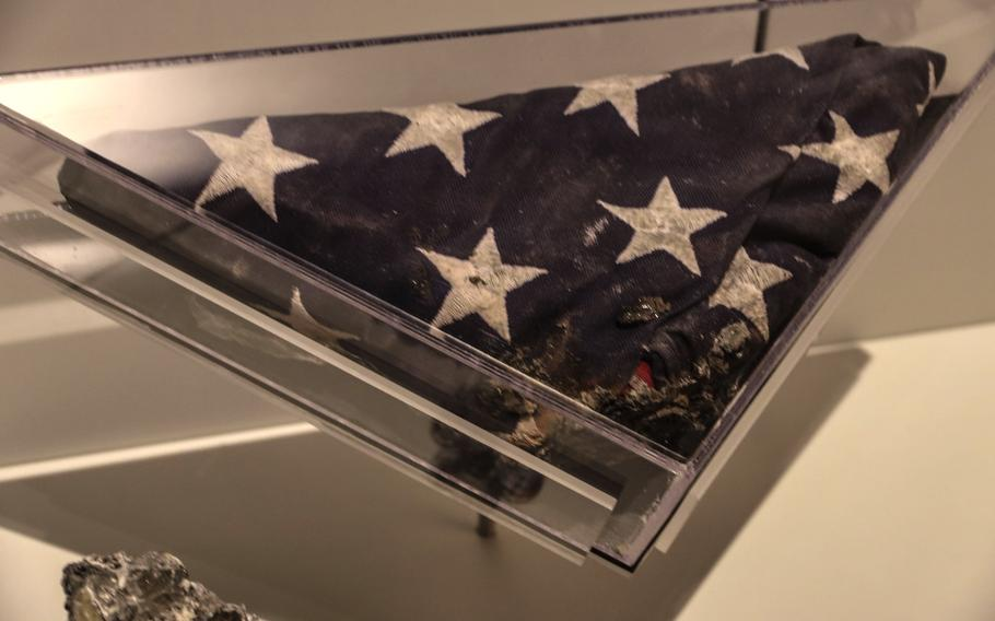 This partially-burned flag with bits of aluminum melted into it, recovered from the Pentagon after the 9/11 attack, is on display at the National Museum of the United States Army.
