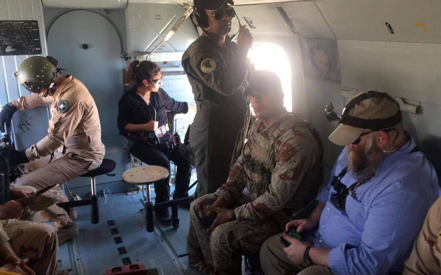Zainab Olivo holds a camera while on a reporting assignment in Iraq with Stars and Stripes journalist Chad Garland, far right, in 2017.