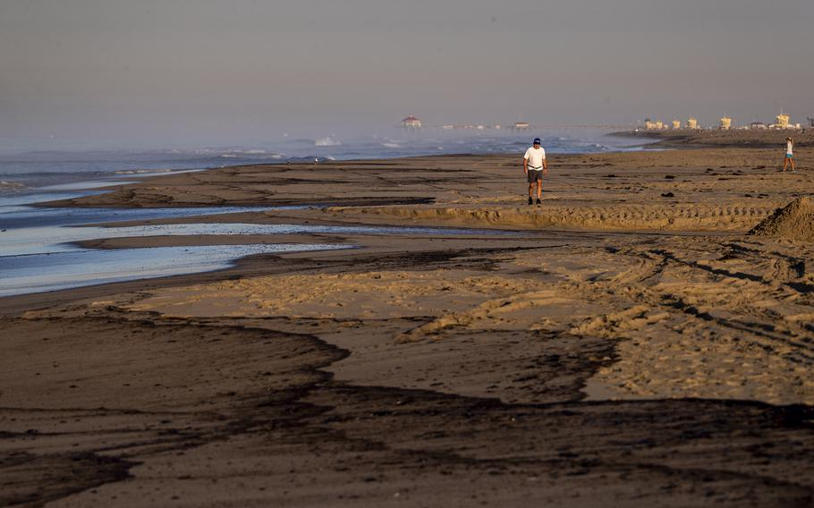 An major oil spill washes ashore at Huntington State Beach in Huntington Beach, Calif., on Sunday, Oct. 3, 2021.