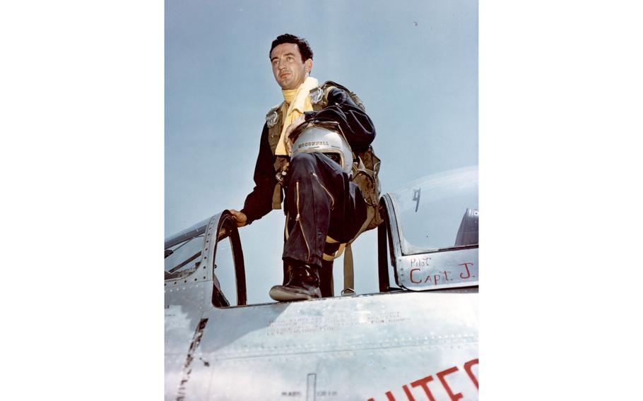 """Capt. Joseph McConnell, Jr., Mohawk Road, Apple Valley, Calif., pilot of the 51st Fighter Interceptor Wing, who became the 27th jet ace of the Korean Conflict on March 9, 1953, is shown leaving the cockpit of his sleek F-86 """"Sabre"""" jet."""