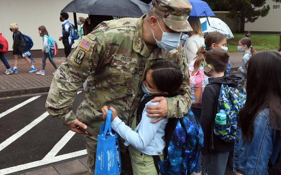 Army Chief Warrant Officer 4 Matthew Keechi hugs his daughter Natalie on Monday, Aug. 23, 2021, before dropping her off at Ramstein Intermediate School for the first day of the new school year.